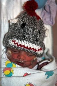 Annie wearing her custom-knit sock monkey hat.