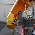 Annie gives Chorizo a congratulatory high five after he won the sausage races.