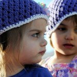 Girls wearing hats from Nana.